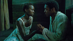 Chiwetel Ejiofor with breakout star Lupita Nyong'o in Steve McQueen's Academy-Award winning drama, 12 Years a Slave.