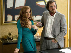 Amy Adams and Christian Bale in one of the top drama films of 2013, American Hustle