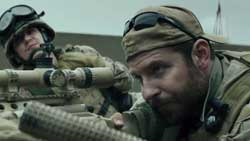 Bradley Cooper takes on a heavy burden as Chris Kyle in the highest-grossing film of 2014, American Sniper.