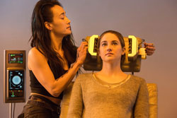 Maggie Q subjects Shailene Woodley to some tests in the 2014 top sci-fi film, Divergent.