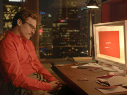 Joaquin Phoenix as a man in love with a machine in 2013 top romance film Her.