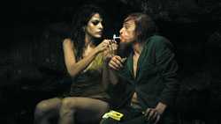 Denis Lavant gets close to Eva Mendes in the mind-bending film Holy Motors.