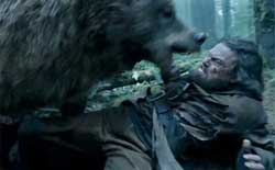 Leonardo DiCaprio has a bad day with a bear in the top action drama of 2015, The Revenant.