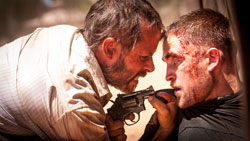 Guy Pearce gets up close and personal with Robert Pattinson in the top drama movie of 2014, The Rover