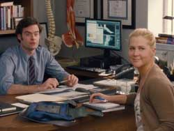 Amy Schumer and Bill Hader make a connection in the top 2015 comedy Trainwreck.